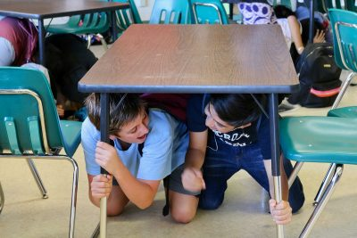Students under desk